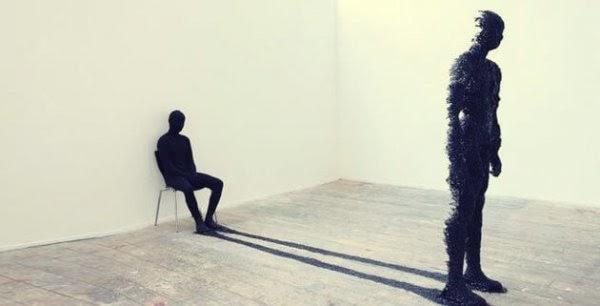 man-sitting-with-his-shadow-600x306.jpg